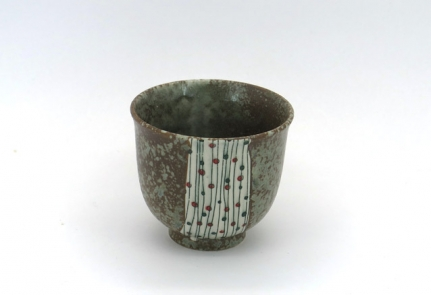 Porcelain cup with paint brush pattern